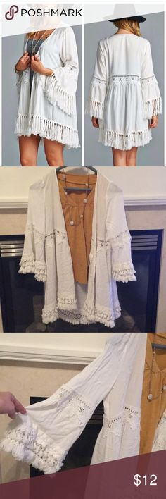 White fringe kimono size medium Adorable white fringe kimono in good condition. There is a very very small pull but nothing that would effect it in any way. Smoke free clean home Jodifl Tops