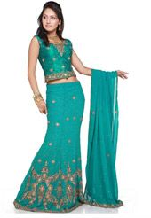 Deep green raw silk mixed with faux georgette lehenga choli in a pattern of fish-tail designed with antique sequins, stones, zari and resham work. Embroidered choli and dupatta is enhancing the look of this indian traditional outfit. (It can be customized as shown upto 48 inches, but for above 40 inches extra charges will be applicable . Slight colour variation possible)