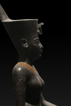 Egyptian war goddess Neith wearing the Deshret crown of northern (lower) Egypt, which bears the cobra of Wadjet