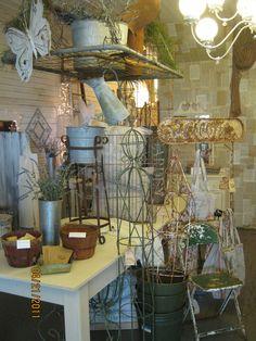 hang a gate or metal mattress spring to display things on