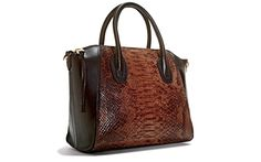 She can fit everything in this Snakeskin bag ($149; Marshalls stores nationwide)