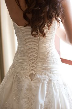 I really like the look of the corcete /lace-up style.  I like this corset look better.   Katie's Wedding Dress Laces