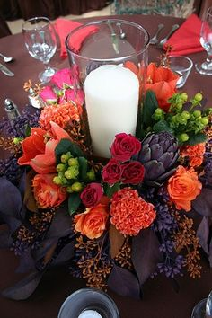 Fall centerpiece Love the white candle in the center of al this color! Great choice!
