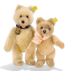A STEIFF JOINTED JACKIE TEDDY BEAR, (5317), beige mohair, brown and black glass eyes, brown stitching, pink highlight to nose, swivel head, felt pads, inoperative squeaker, script button with yellow cloth tag and U.S. zone tag, 1953-55 --6¾in. (17cm.) high (slightly worn and labels worn); and a maize mohair Teddy Baby, (7322), brown and black glass eyes, shorter mohair muzzle and feet, open felt mouth, swivel head, jointed limbs, felt pads, inoperative squeaker, blue collar with bell…