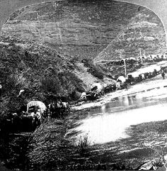 A Mormon wagon train on its way to Utah, photographed by C. W. Carter in 1879.