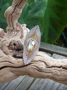 Athena, beadwoven ring. $75.00, via Etsy.