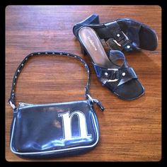 """EUC  LIMITED TOO Mini Purse Faux leather, black with blue metallic NY """"n"""" on front, with silver studded short strap.  Open bag with small interior side zipper pocket.  Super cute, versatile bag!  8.25"""" x 5"""" x 1.5"""".  Clean condition with one small discoloration on back edge (see pic 4); unnoticeable in use. Limited Too Bags Mini Bags"""
