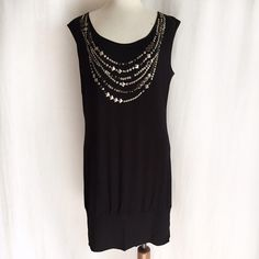 """BCBGMAXAZRIA Jersey Mini Dress/Tunic✨Host Pick✨ Super soft jersey knit tunic embellished with beads and mixed metal shapes. Scoop neck in front and deep v-neck in back enhanced by a single tie across the shoulders. Banded hem. Can be worn as a mini dress or a tunic over leggings or jeans. Hand wash. 95% rayon; 5% spandex. Size is Medium but fits closer to Large or a size 10/12. Bust: 20"""" flat across. Waist: 35"""" across. Hip: 38"""" across. Length: 35"""". Gently worn in EUC. BCBGMaxAzria Dresses…"""