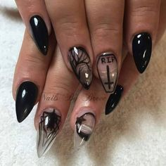 Gothic occult stiletto nails. Rip art. Negative space black claws.