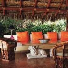 Mexican villa offers a large open-air recreation space that is located under a thatched palm-frond-roofed palapa.