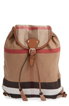 Absolutely in love with this Burberry check print backpack accented with leather tassels for a vintage-chic touch.