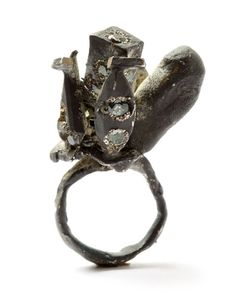 Karl Fritsch  Ring: Untitled 2009  Silver, green sapphires... Probably worth a fortune, but the ugliest thing I've ever seen!