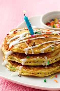 Start a new birthday tradition: Cake Batter Pancakes with glaze and sprinkles!
