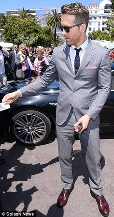 Always obliging: The hunk stopped briefly to sign autographs for fans as he made his was i...