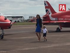 The Duchess of Cambridge walks across the airfield at @airtattoo with Prince George
