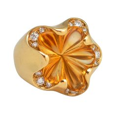 18 k gold ring, centering a fancy-cut citrine with full cut diamond accents . Signed FRED PARIS ATF10032.Circa 1990s