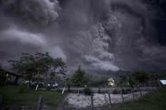 Clouds of ash fill the sky after an eruption by the Colima volcano, known as the Volcano of Fire, near the town of Comala, Mexico. The volcano spewed ash more than 4 miles into the air.