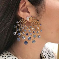 Sapphire and diamond ear clips, by Bhagat. Via FD-Gallery.