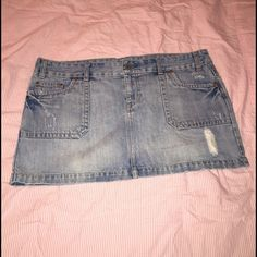 """Size 14 American Eagle jean skirt. American Eagle distressed jean skirt. Size 14. Perfect skirt for summer!! Length is 13"""". American Eagle Outfitters Skirts Mini"""