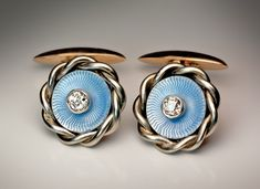 A pair of antique Russian white (18K) and rose (14K) gold cufflinks with pale blue guilloche enamel and diamonds. Made in St. Petersburg between 1908 and 1917 by Rudolf Weide.