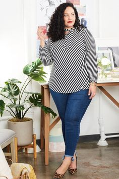 Girl With Curves Fall 2017 Plus Size Clothing Collection. Stripe Blouse With Step Hem Skinny Jeans.