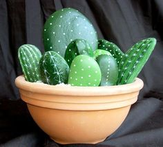 I love this idea!! River rock painted to resemble cactus!! Smart............ummm, are cactus REALLY that hard to grow?  You don't even have to water them!!
