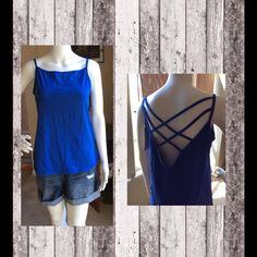 Blue tank top Blue tank top with super cute open crisis cross back. Tops Tank Tops