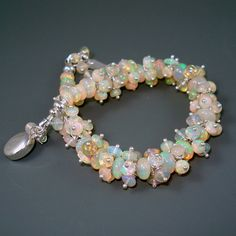 Oh my, this is sooooooo pretty!  Opal Bracelet Ethiopian Fire Opals Opal Cluster by JewelryByJacoby, $399.00