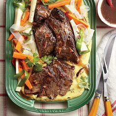 Company Pot Roast with Creamy Mushroom Grits | Bacon, garlic, and red wine imbue humble chuck roast with robust character and rich beef-bourguignon flavor as the meat transforms in the slow cooker. | SouthernLiving.com