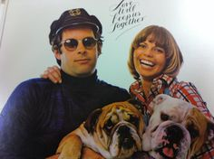 """""""Love Will Keep Us Together"""",was written by Neil Sedaka and Howard Greenfield,first appearing on Sedaka's 1973LP The Tra-La Days Are Over.The Captain & Tennille cover would reach #1 on the Billboard Hot 100 for the week ending June 21,1975.The cover of the album features a photo of Tennille and Dragon sitting with two of their bulldogs.  Lyrics http://www.metrolyrics.com/love-will-keep-us-together-lyrics-captain-and-tennille.html  Video http://www.youtube.com/watch?v=1G0sOA6hTg0"""