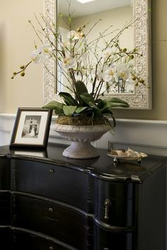 Entry.  Always love black lacquered furniture.  Nice millwork too.