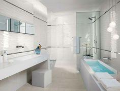 Salle de bain avec douche italienne et un carrelage neutre et stylé