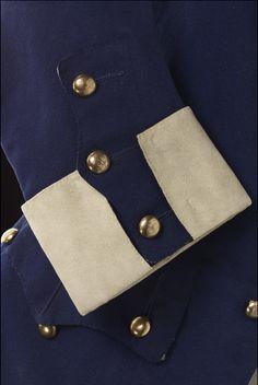 Royal Navy Midshipman's Uniform (image 4 - detail) | England | 1748 | brass; linen; wood; wool | National Maritime Museum, Greenwich | Object ID: UNI0006