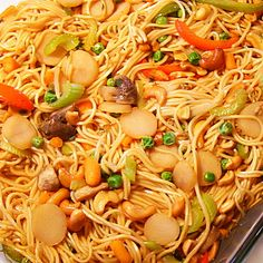 Chinese Noodle Casserole Recipe Main Dishes with Chinese egg noodles, beansprouts, cashew nuts, frozen peas, water chestnuts, celery, sliced carrots, green onions, ginger, red bell pepper, green bell pepper, fresh mushrooms, water, soy sauce, granulated sugar, corn starch, water