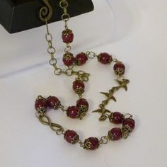 Check out this item in my Etsy shop https://www.etsy.com/listing/90585649/ruby-quartz-and-bronze-chain-necklace