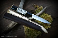 Viking seax with damascus blade, engraved handle and decorated sheath