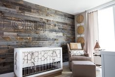 Faux Wood Accent Wall in this Rustic Travel Nursery