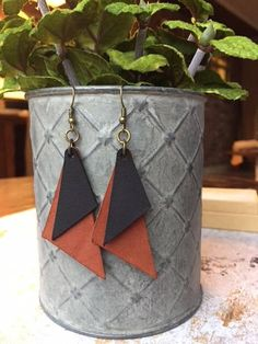 This listing is for a pair of super cute double triangle leather earrings. Can be made in any combination of these three colors: Dark Brown, Light Brown and Black. Please feel free to message me with any special requests you have.