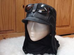 Unisex Hat Beautiful Aviator/Pilot Hat, with real black leather. The Inside is all black lining, so it's a comfortable hat for spring or Fall. This high quality handmade hat is made with genuine leather. Straps adjustable and flaps can be lifted and attaches behind the head and also under th