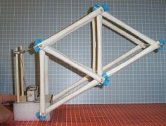rolled tube structures - this one uses a lifting mechanism