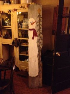 Painted snowman on old board. LOOK BRIAN, KAYLA, MEGAN, AND JENNA WATTERSON....CHRISTMAS IS COMING!
