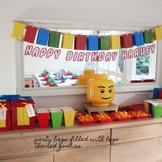 Lego Birthday Party Ideas- Love the bunting and the lego sorting head as a decoration.