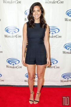 "Olivia Munn attends ""Deliver Us From Evil"" Photo Call at WonderCon Anaheim 2014 in Anaheim, California in a Valentino navy romper paired with Sophia Webster sandals, Dana Rebecca Designs earrings, and rings by Graziela Gems, Dana Rebecca Designs, EF Collection."