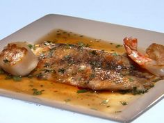 Get Main Challenge: Grilled Barramundi with Wasabi Sauteed Shrimp and Scallops in an Asian Broth Recipe from Food Network