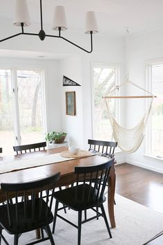 What if we put a hammock chair in the dining room? Genius. Gorgeous Kansas City Home Tour Featuring Paige Whitmore