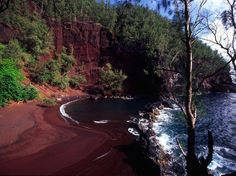 Though Maui's best known for its pale, silky sands, Kaihalulu Beach, or Red Sand Beach, is famous for its fine, terracotta-colored sand. Set against dark, jagged lava rock and sloping gently into emerald-colored waters, Kaihalulu looks almost otherworldly. Worth a visit, if you can find it: It's nestled in a well-hidden cove just south of Hana.Read more: 12 Unusual Beaches You Won't Believe Exist