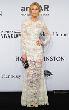 Toni Garrn in an Elie Saab white long sleeve lace gown