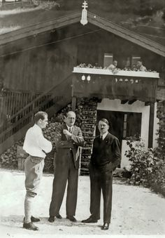 Eva Braun took this photo of Hitler with Hess and an unidentified man, circa 1934.This is on the Obersalzberg (note the power lines over the roof?)