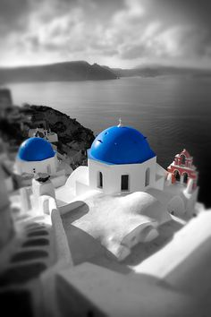 Oia, ( Ia ) Santorini - Blue domed Byzantine Orthodox churches, - Greek Cyclades islands - Photos, pictures and images
