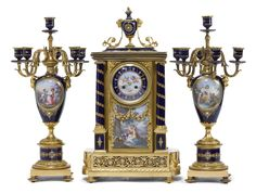 A FINE LOUIS XVI STYLE GILT BRONZE MOUNTED SÈVRES STYLE CERAMIC AND JEWELED ENAMELS THREE PIECE CLOCK GARNITURE Paris, circa 1895